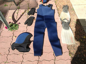 "Full scuba 1/4 "" licra wet suit ,weight belt, weights and fins ."
