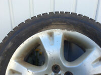 Three Firestone tires 205-55R16 studded M+S with RIM