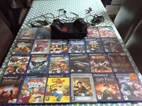 Ps2, 2 wired controllers, 22 games.