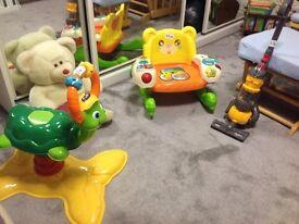 Three toys and a teddy bear