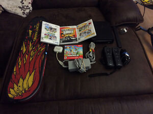 Nintendo Wii | comes with 4 games, two remotes, and more