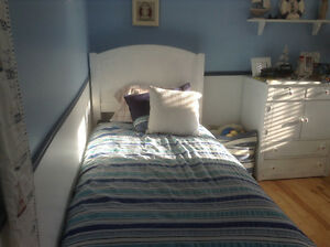 single white washed bed
