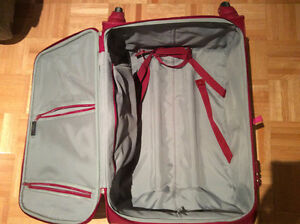 RED DELSEY SUITCASE IN PERFECT CONDITION