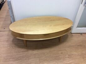 Modern oval coffee table with drawer and tapered leg