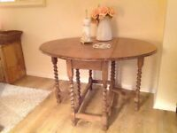 Spindled leg dining/console/side table