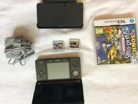 Nintendo 3DS black. Excellent condition. Cradle charger and two games