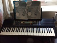 Electric Keyboard, with manual, music books, music stand, and adjustable keyboard stand
