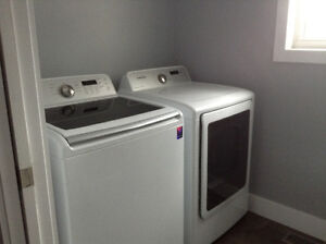 A black and white washer and dryer:SAMSUNG