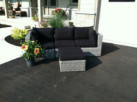 Versatile Grey Wicker(Resin) Couch & Ottoman with Black Cushions
