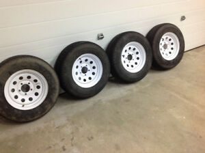 Four trailer tires and rims ST205/75R14. Lug pattern 5x4.5.