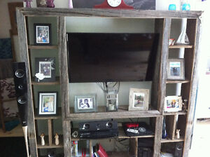 Antique entertainment center made out of reclaimed barm board