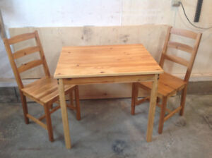 Refinished pine table and two pine chairs