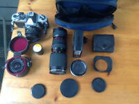 Vintage Nikon, lens, film and carrying case