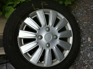 Four 185/65R15 Snow Tires with Rims