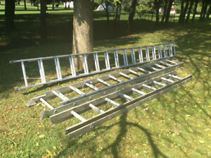 Three extension ladders