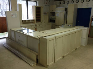 Full Cream-Coloured Kitchen with Marble Top and Appliances