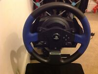 Gaming chair with wheel and pedals