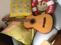 Small guitar with case