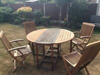 Outdoor 4 seater wooden garden table and chairs.