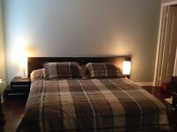 King size bed with mattress and dresser and mirror