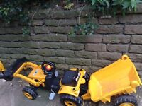 Yellow digger toy with trailer