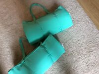 Two camping or picnic cushions