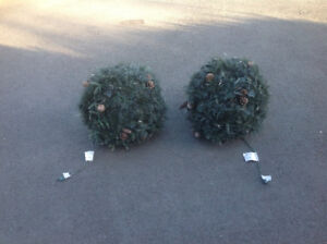 Two outdoor Christmas lighted globes