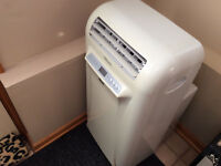 Floor model air conditioner. With attachments