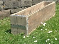 Recycled wooden planters for sale.