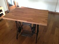 Solid oak table with antique cast iron stand