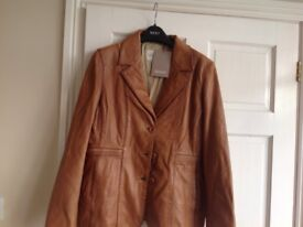 Brand new soft tan leather jacket,size 16.bought at Lakeland leather