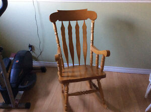 Heavy, solid wood rocking chair