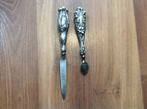 ANTIQUE STERLING SILVER NAIL FILE AND CUTICLE TOOL.