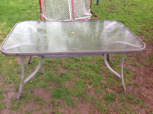 """GLASS TOP PATIO TABLE 60.5"""" X 38.5"""" - GOOD SOLID CONDITION"""
