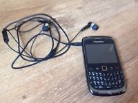 Blackberry with charger and headphones