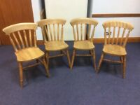 A set of 4 antique farmhouse style solid pine chairs.