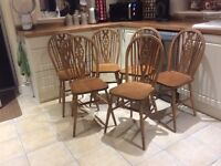 6 wheel back wooden chairs