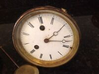 ANTIQUE FRENCH BELL STRIKING PORCELAIN FACED CLOCK MOVEMENT. COMPLETE WITH PENDULUM.