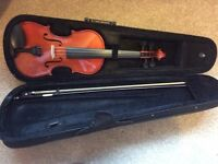 Violin in case, as new.