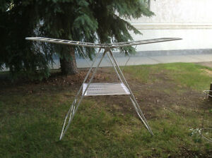 Collapsible clothes drying rack great for inside or outside.