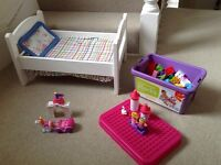 An IKEA wooden dolls bed and princess castle Lego style blocks