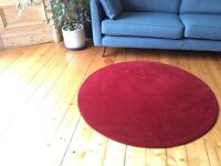 wool round red rug 130 cm diameter. Excellent condition