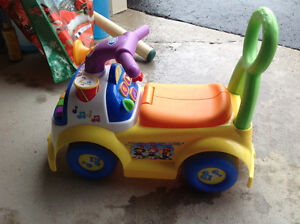 Fisher price musical ride on toy