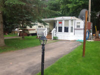 Park Model style trailer on lake view lot