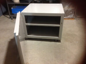 Metal office storage cabinet on castors. $25.00