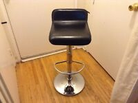 Small bar stool goes up and down