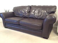 3 piece suite with footstool (with storage) in brown leather in great condition. £150 bargain