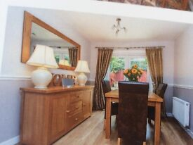 Dining table and 4 chairs, sideboard and wall mirror