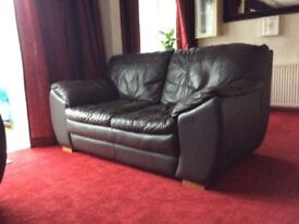 Dark Brown Leather 4 & 3 seater sofas and pouffe DFS Suite