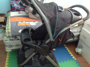 Stroller with carrier and car seat attachment